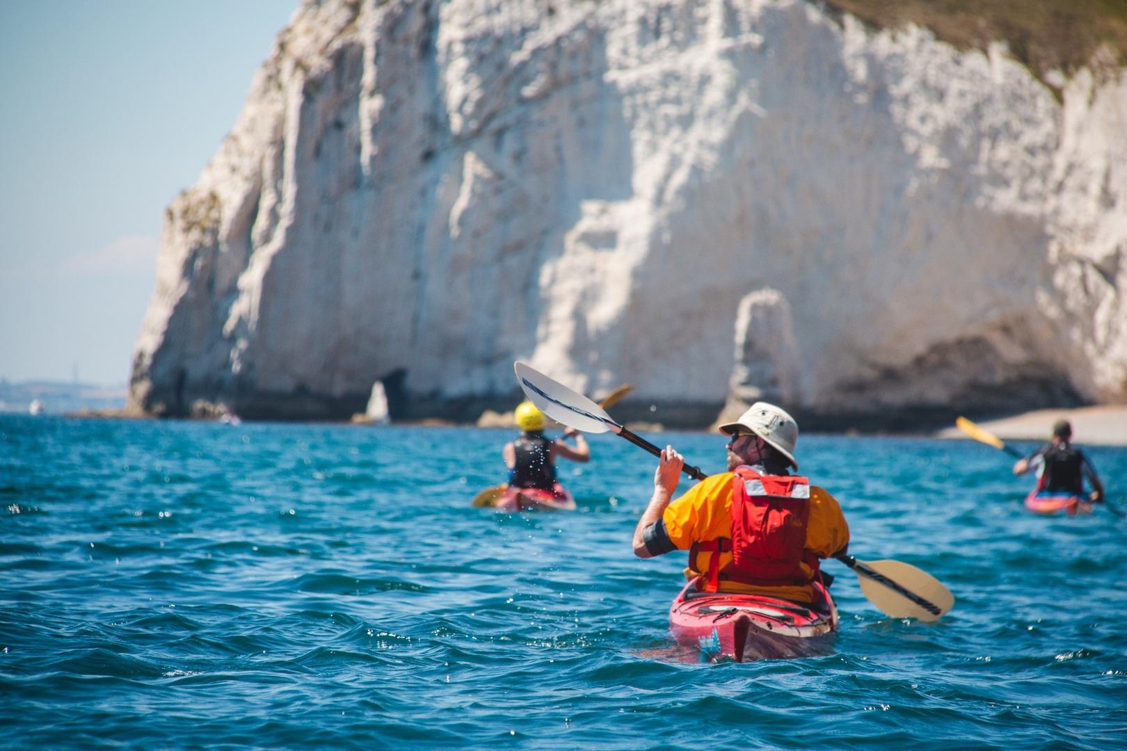 Social distancing paddling on the Dorset coast